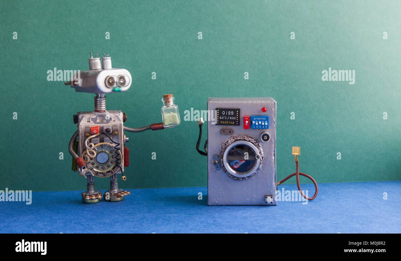 Robot automation laundry room. Silver washing machine, green wall interior, blue floor. Funny toys creative design. - Stock Image
