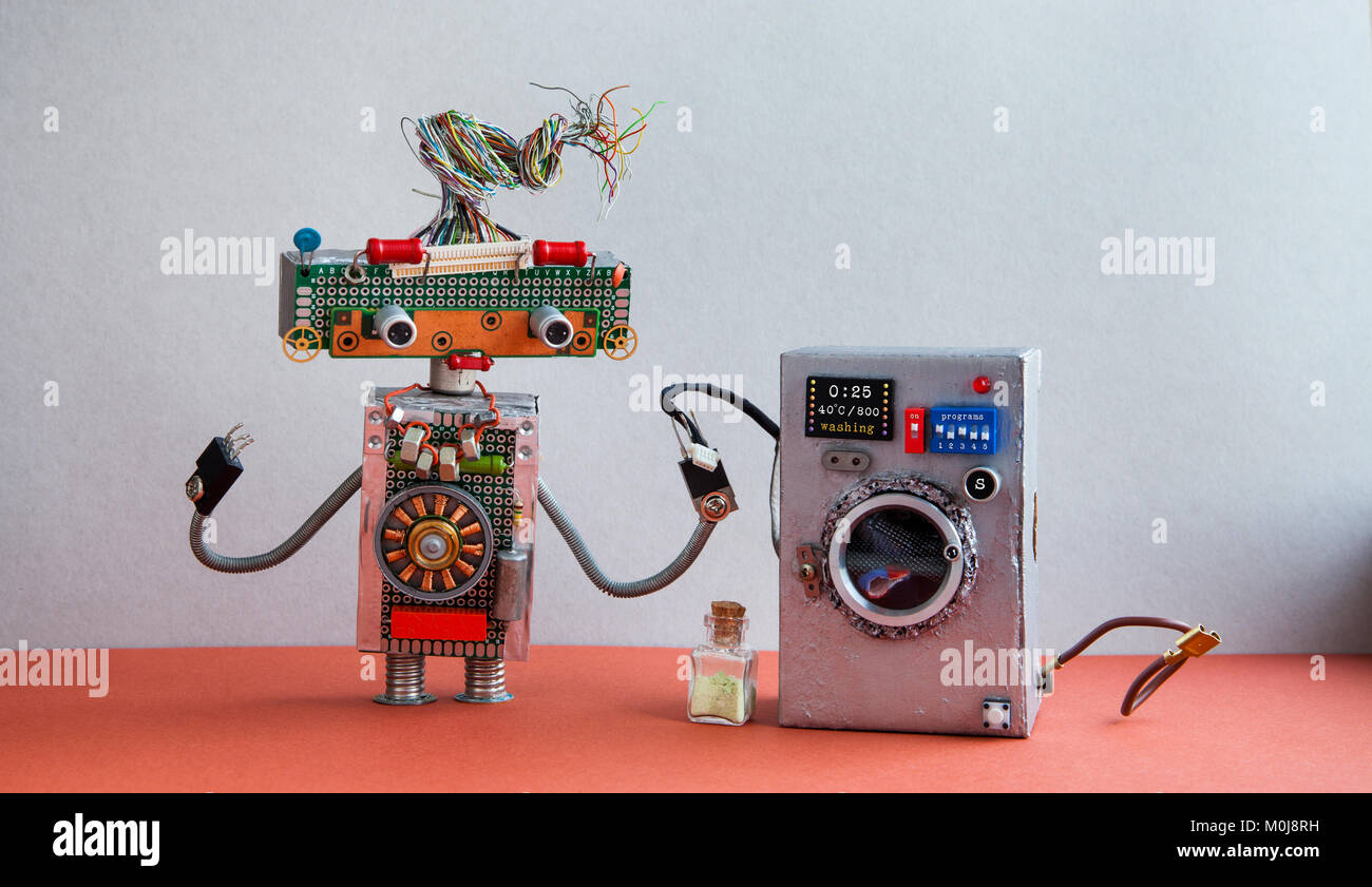 Robot automation laundry room. Silver washing machine, gray wall interior, red floor. Funny toys creative design - Stock Image