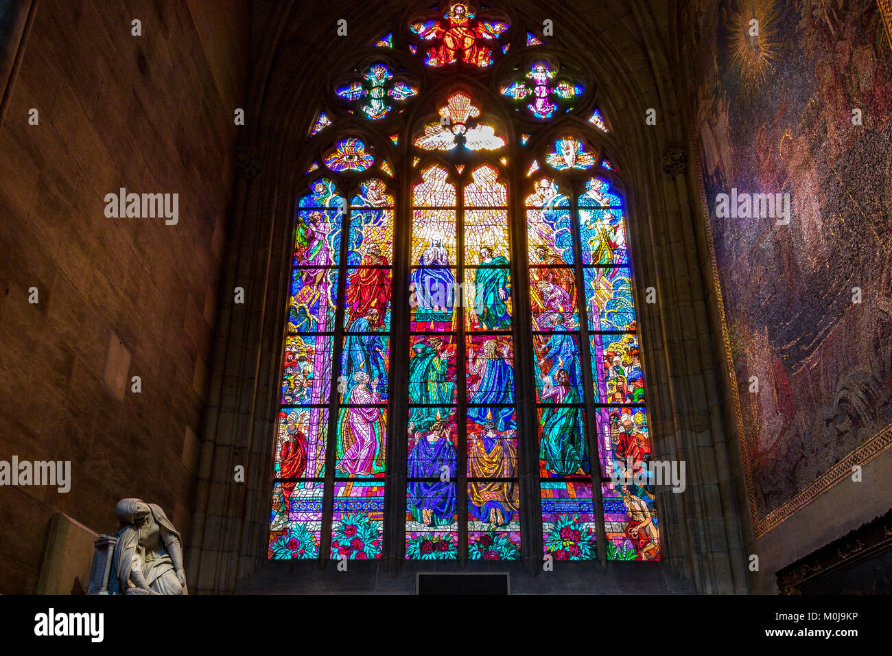 The chapel of St Ludmila in Prague's St Vitus Cathedral features the beautiful stained glass Pentecost stained - Stock Image