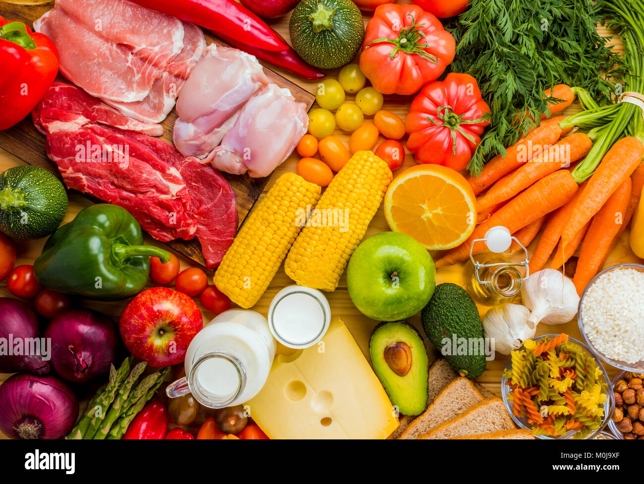 Different types of food from the food pyramid seen from above. Stock Photo