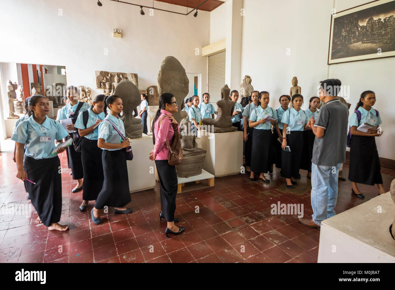 School girls in the Gallery of Khmer Art at the National Museum of Arts; Phnom Penh, Cambodia - Stock Image