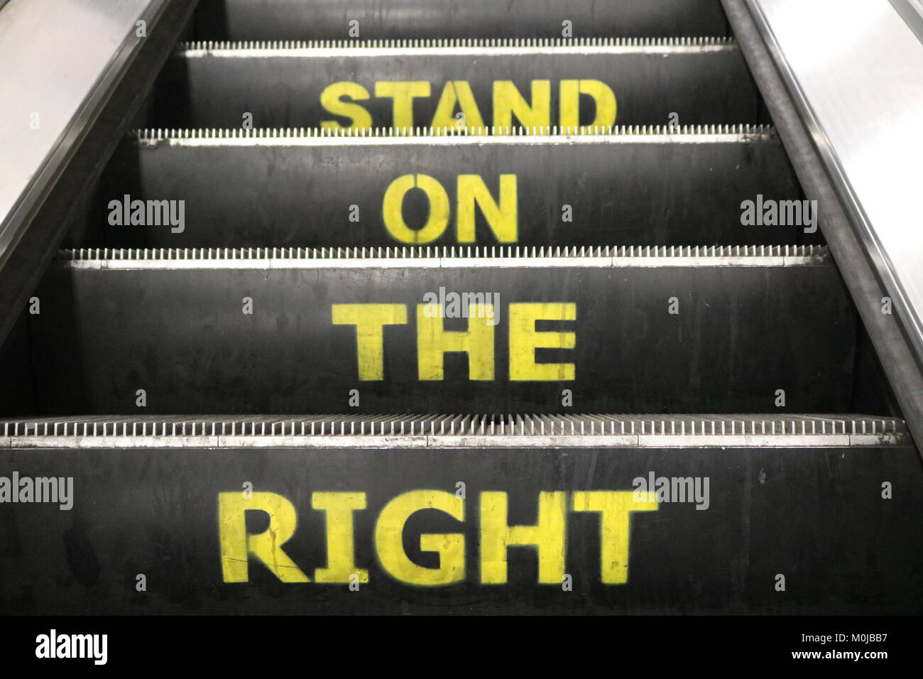 'Stand On The Right' sign on escalator, London - Stock Image