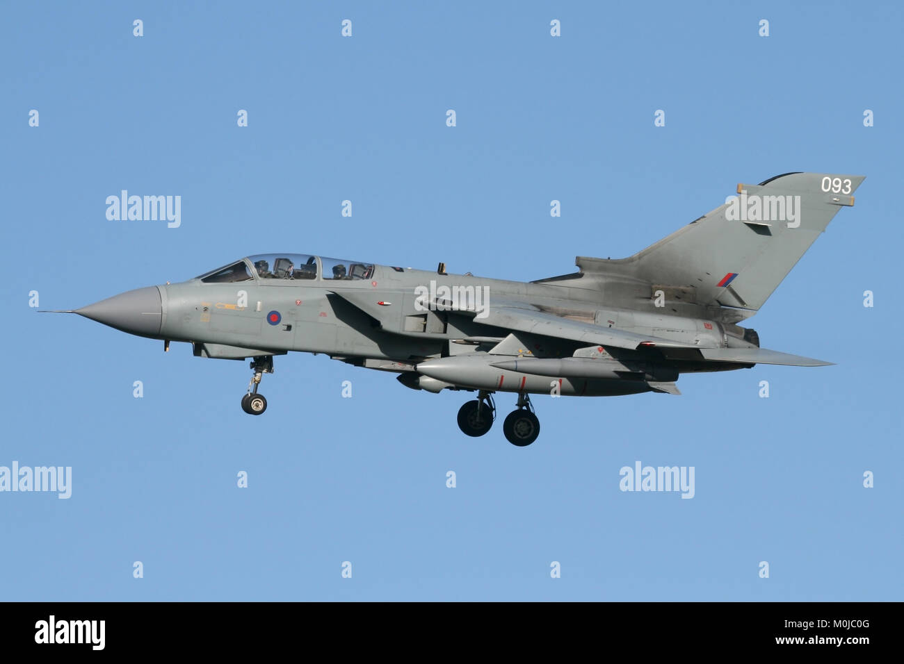 Unmarked RAF Tornado GR4 from the Marham wing turning onto final approach on a bright clear day. - Stock Image