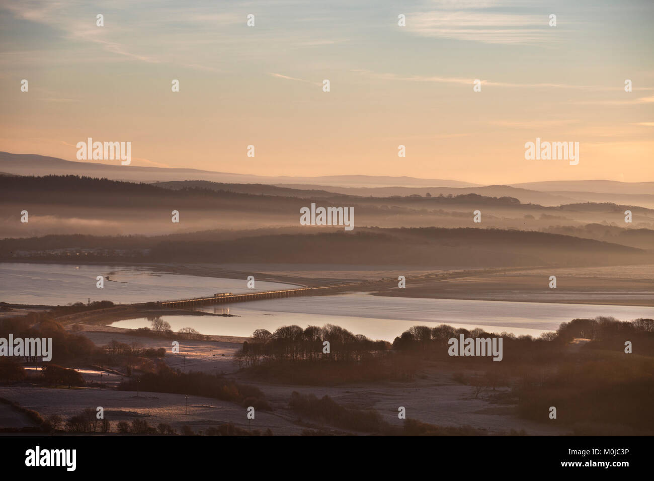 Levens Viaduct (river Levens, Ulverston, Cumbria) Direct Rail Services   nuclear flask train crossing at sunrise - Stock Image
