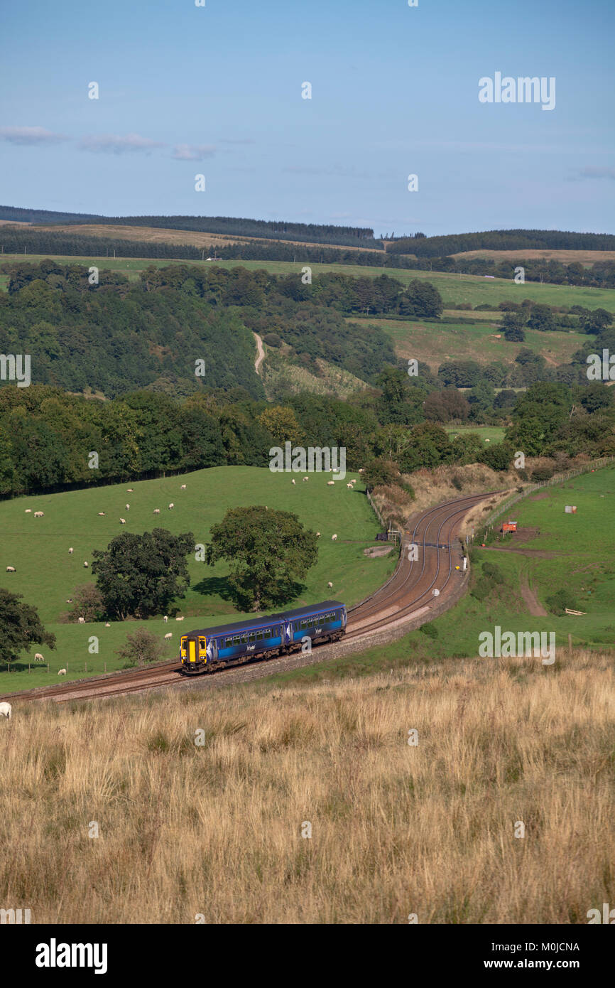 Scotrail sprinter train passes  Upper Denton (west of Haltwhistle in the Tyne Valley) with a Newcastle - Glasgow Stock Photo