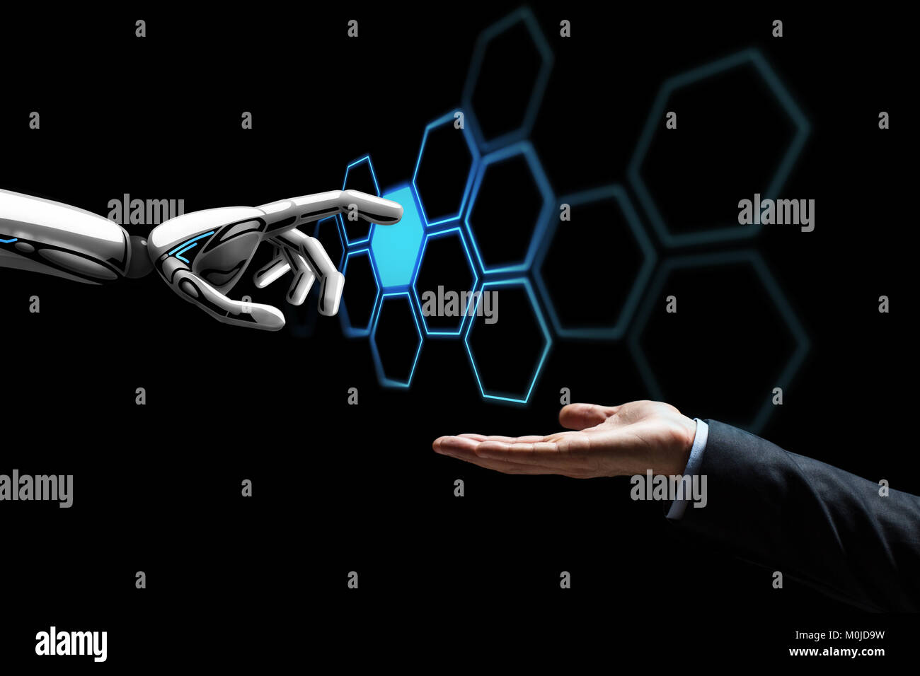 human hand and robot touching network hologram - Stock Image