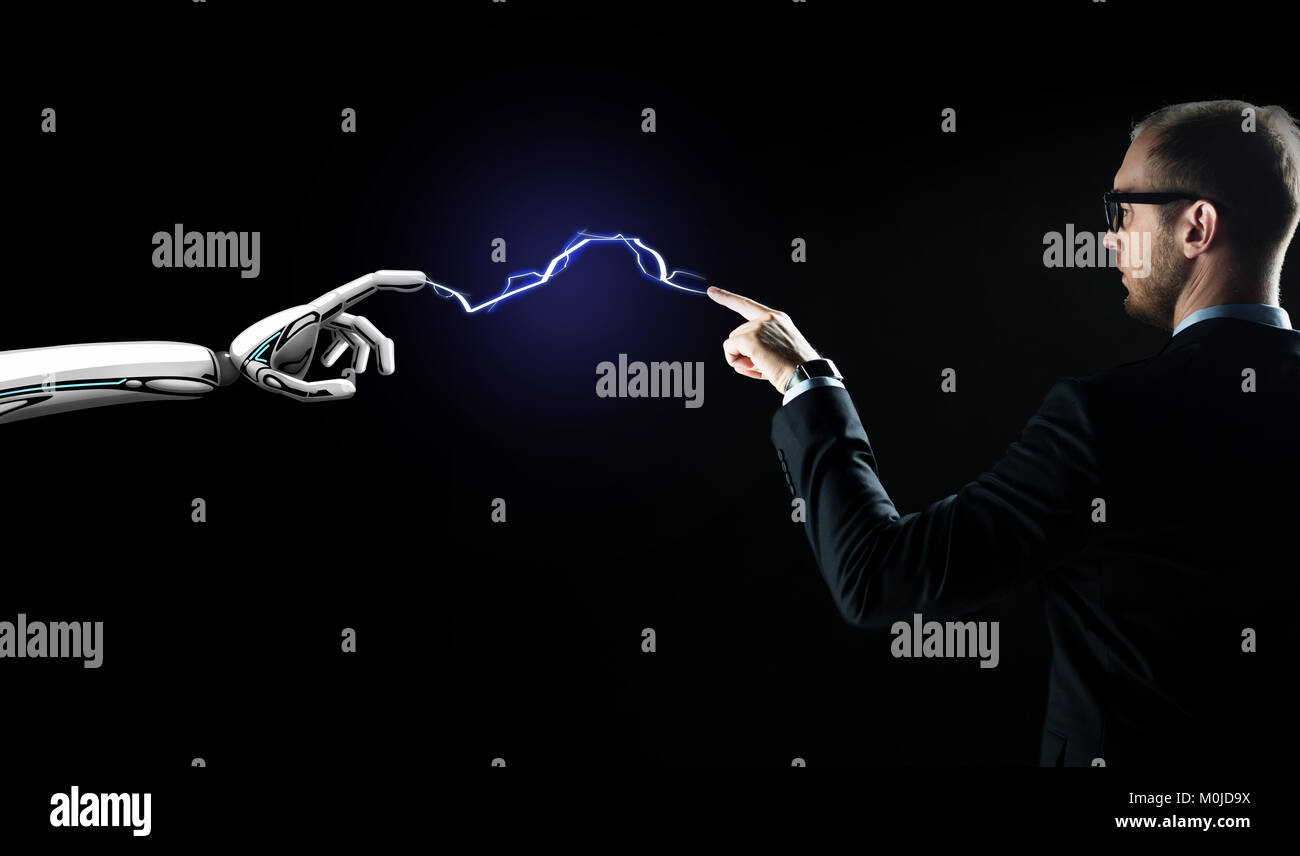 robot and businessman connected by lightning - Stock Image