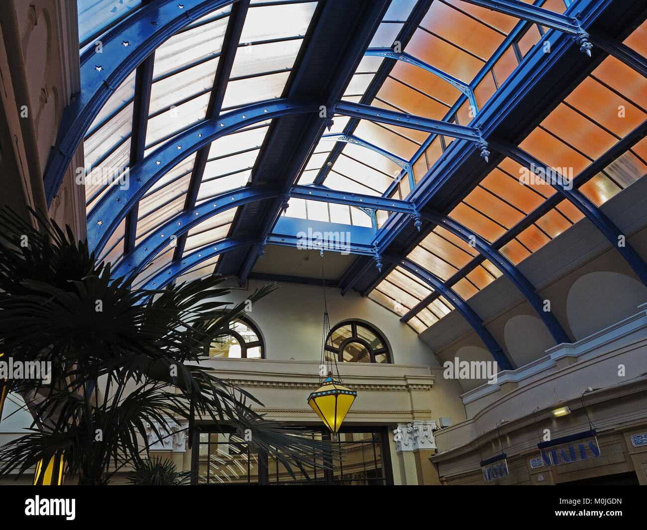 colours reflecting through a section of the glass roof of Blackpool's Winter Gardens - Stock Image