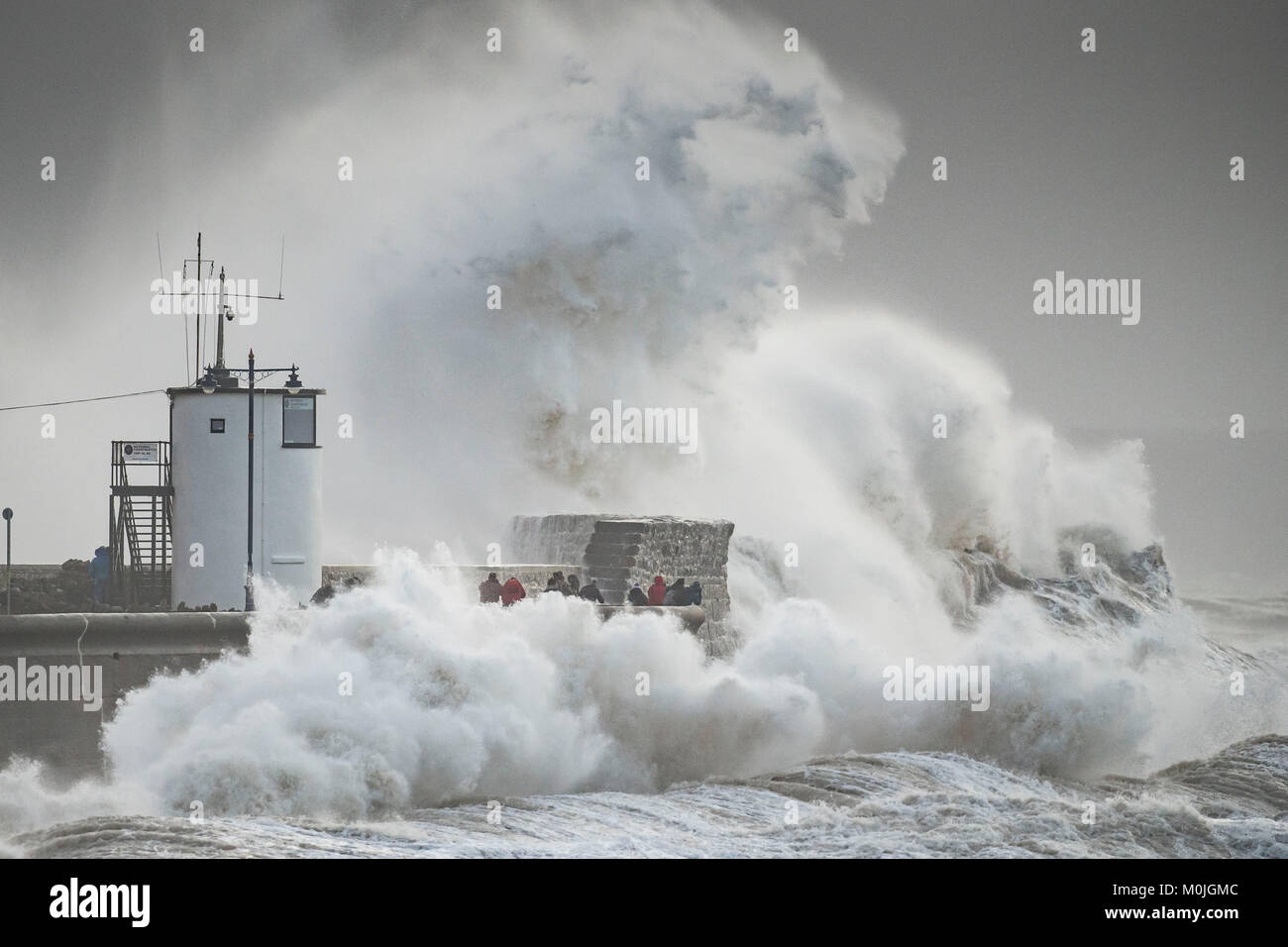 Waves crash against the harbour wall at Porthawl, South Wales, UK during storm Eleanor. The Met Office issued a weather warning for strong winds. Stock Photo