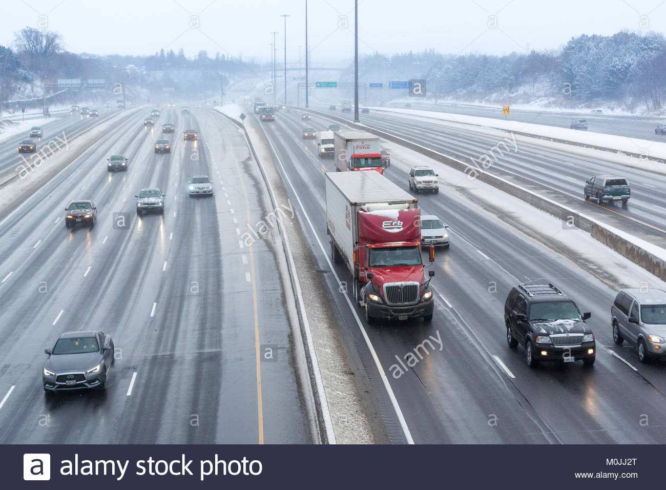 Winter freezing rain storm creates dangerous driving conditions on Highway 401 in Pickering Ontario Canada - Stock Image