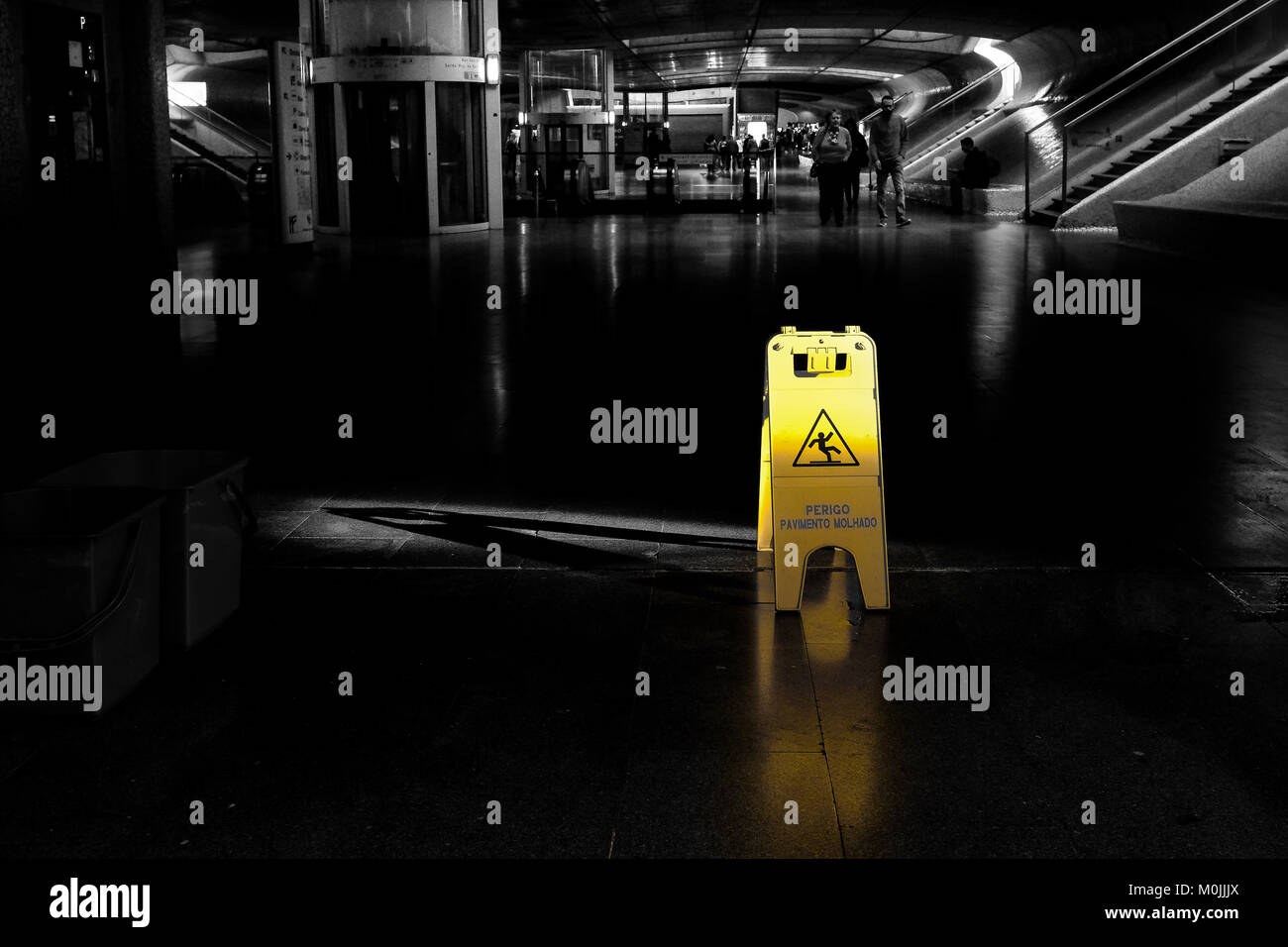 Warning sign on slippery floor ahead - Stock Image