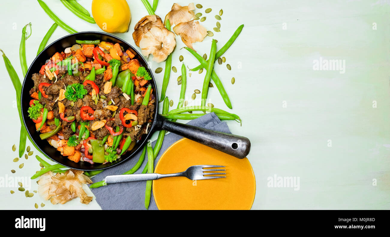 Pulled oats in a rustic pan. It is a meat substitute novelty and made from Nordic oats and beans. It is also called - Stock Image