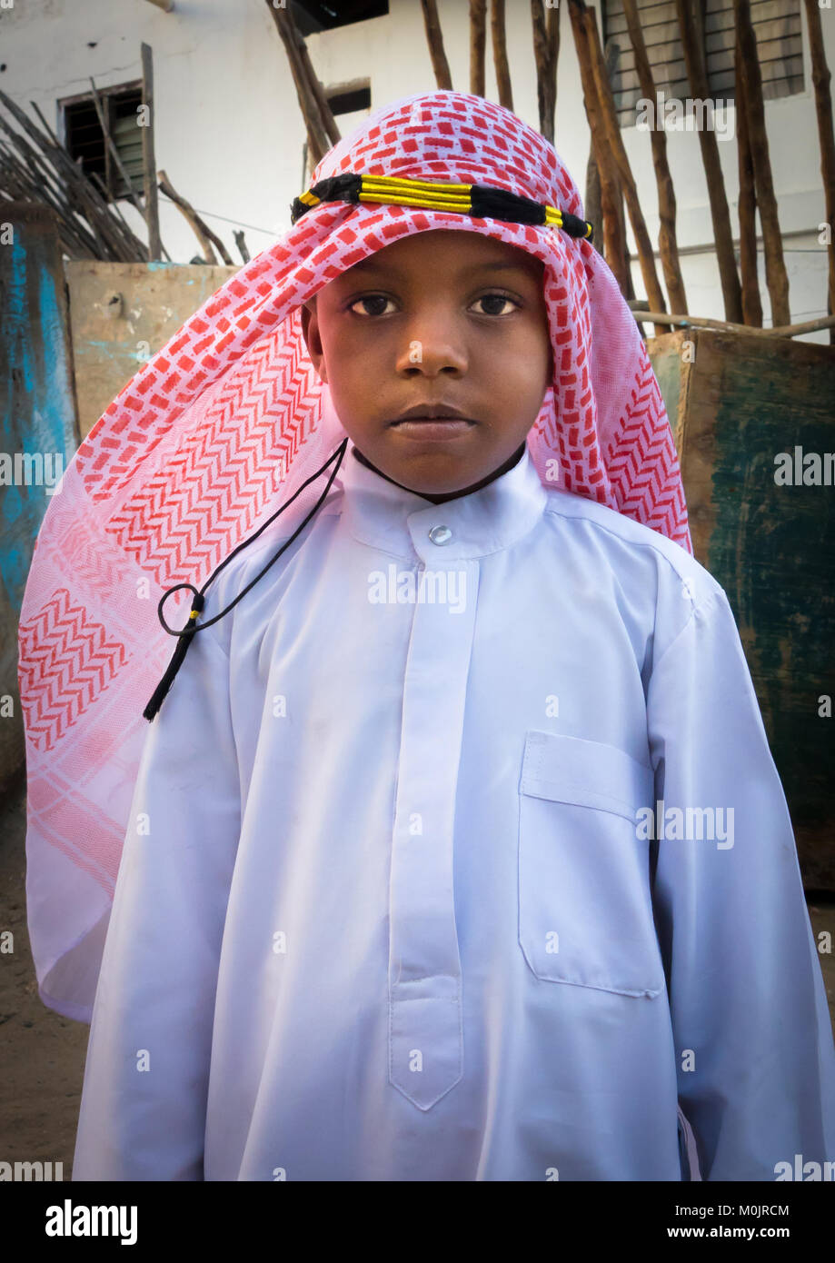 Kid wearing traditional suit for the Mawlid festival, Lamu Island, Kenya - Stock Image