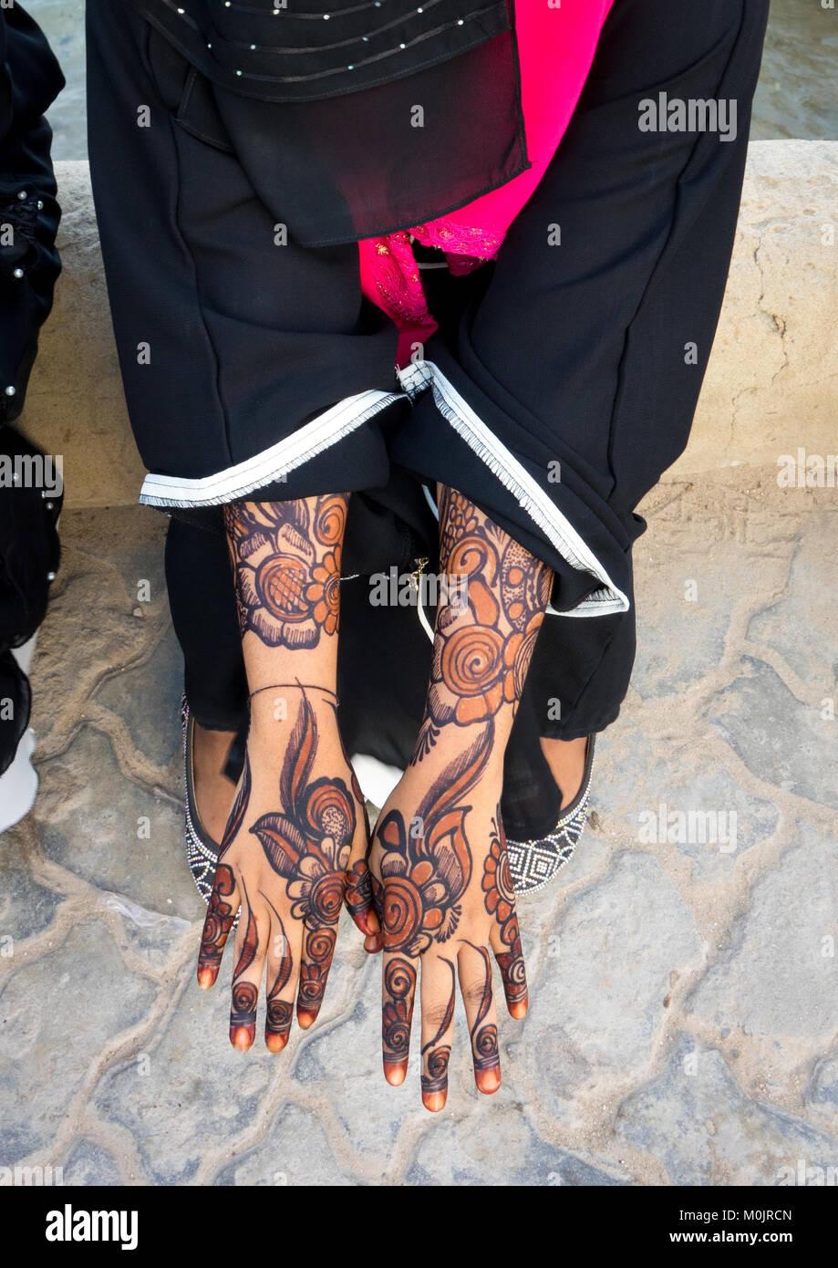 Woman wearing a burqa showing her henna painted hands, Lamu Island, Kenya Stock Photo