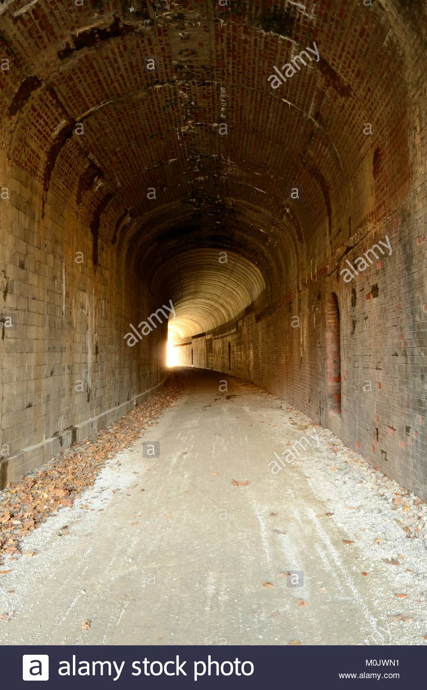 Light at the end of the tunnel. Inside Bonds Creek Tunnel, North Bend Rail Trail, Ritchie County, West Virginia. - Stock Image