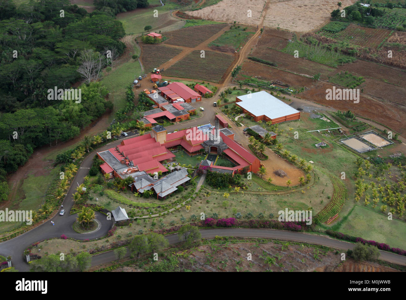 Agricultural factory/refinery, aerial from a helicopter, The Republic of Mauritius. Stock Photo
