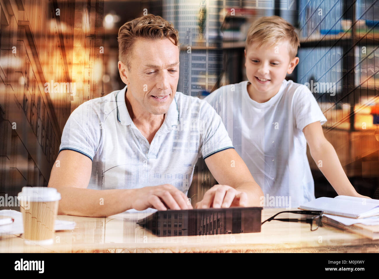 Attentive male person working with his gadget - Stock Image