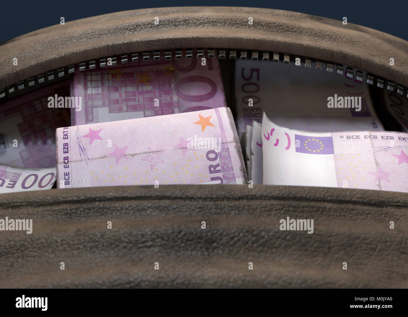 A concept depicting an open brown leather duffel bag revealing bundles of illicit rolled euro notes - 3D render - Stock Image