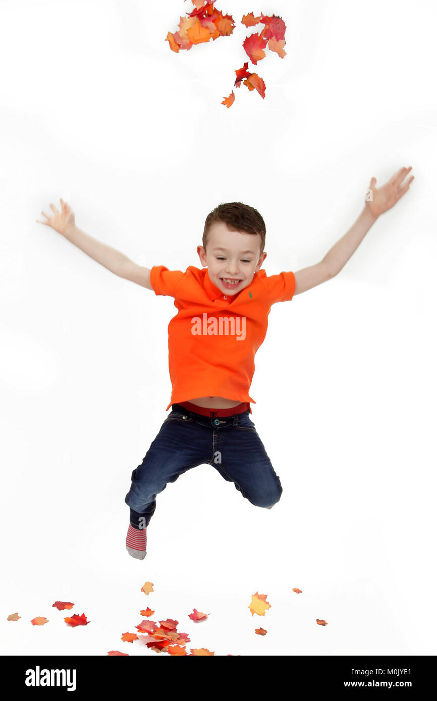 6 year old boy full of energy, Jumping and having fun, happy excited child,  ADHD, Going crazy, medical condition - Stock Image