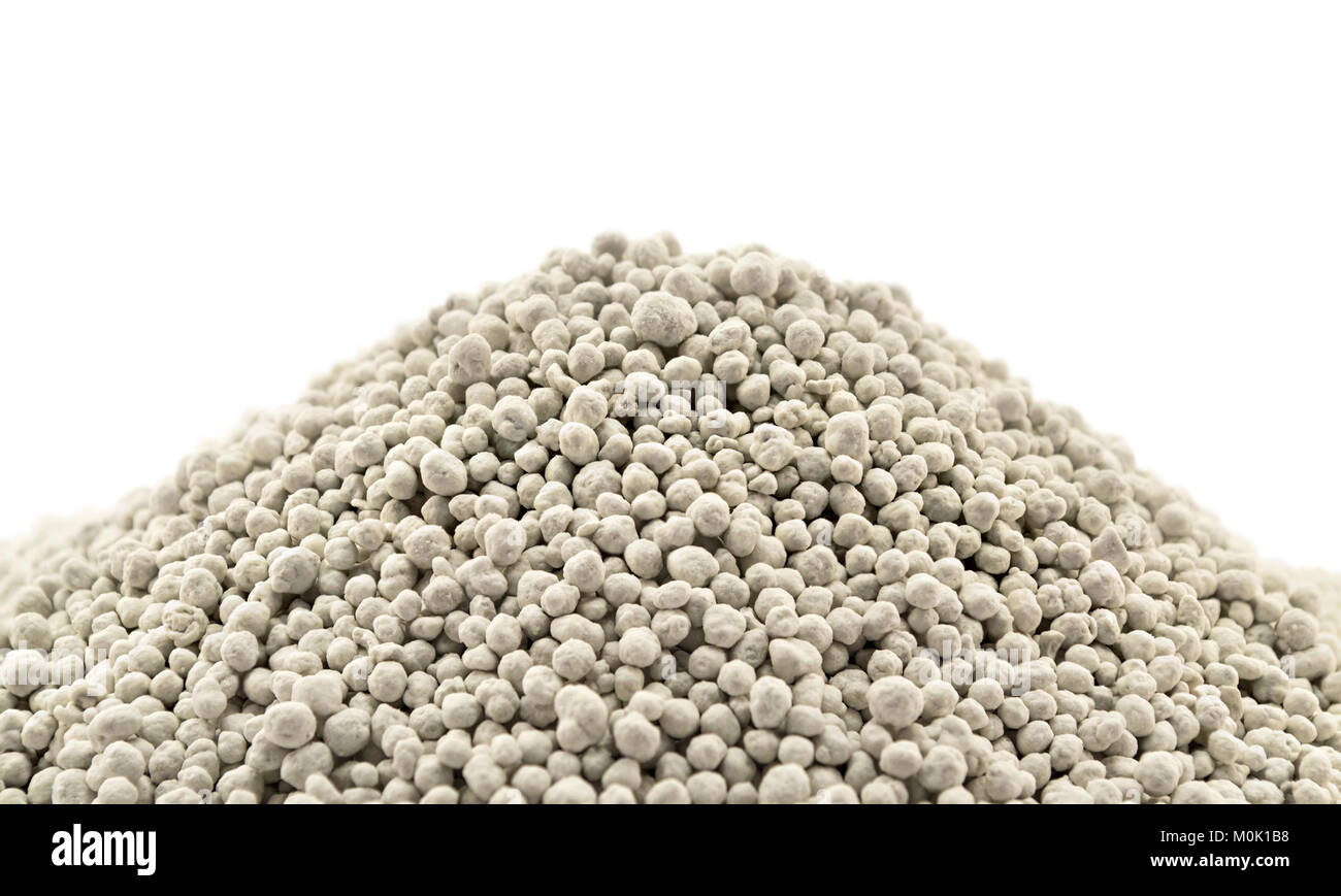 Heap of mineral fertilizers, isolated on the white background - Stock Image