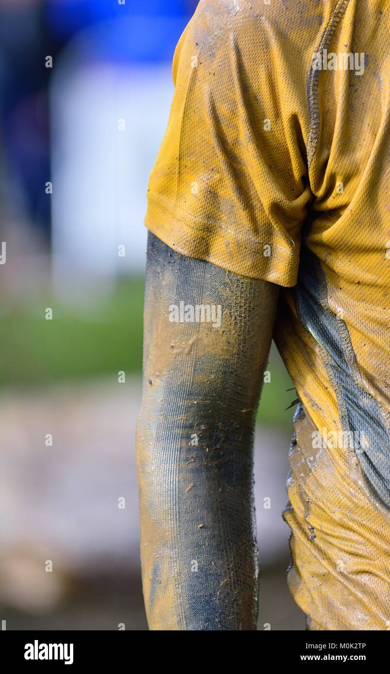 Focused sportsman's hand in dirty sportswear. Close-up. Unrecognizable - Stock Image