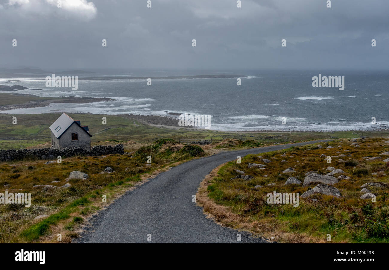 Approaching squall along a windswept road, County Donegal Ireland - Stock Image