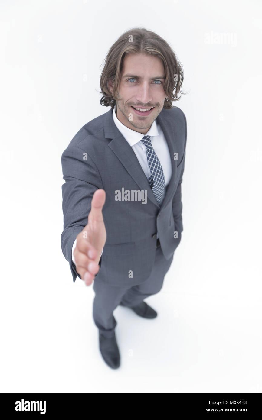 Business man extending hand to shake - focus om hand Stock Photo