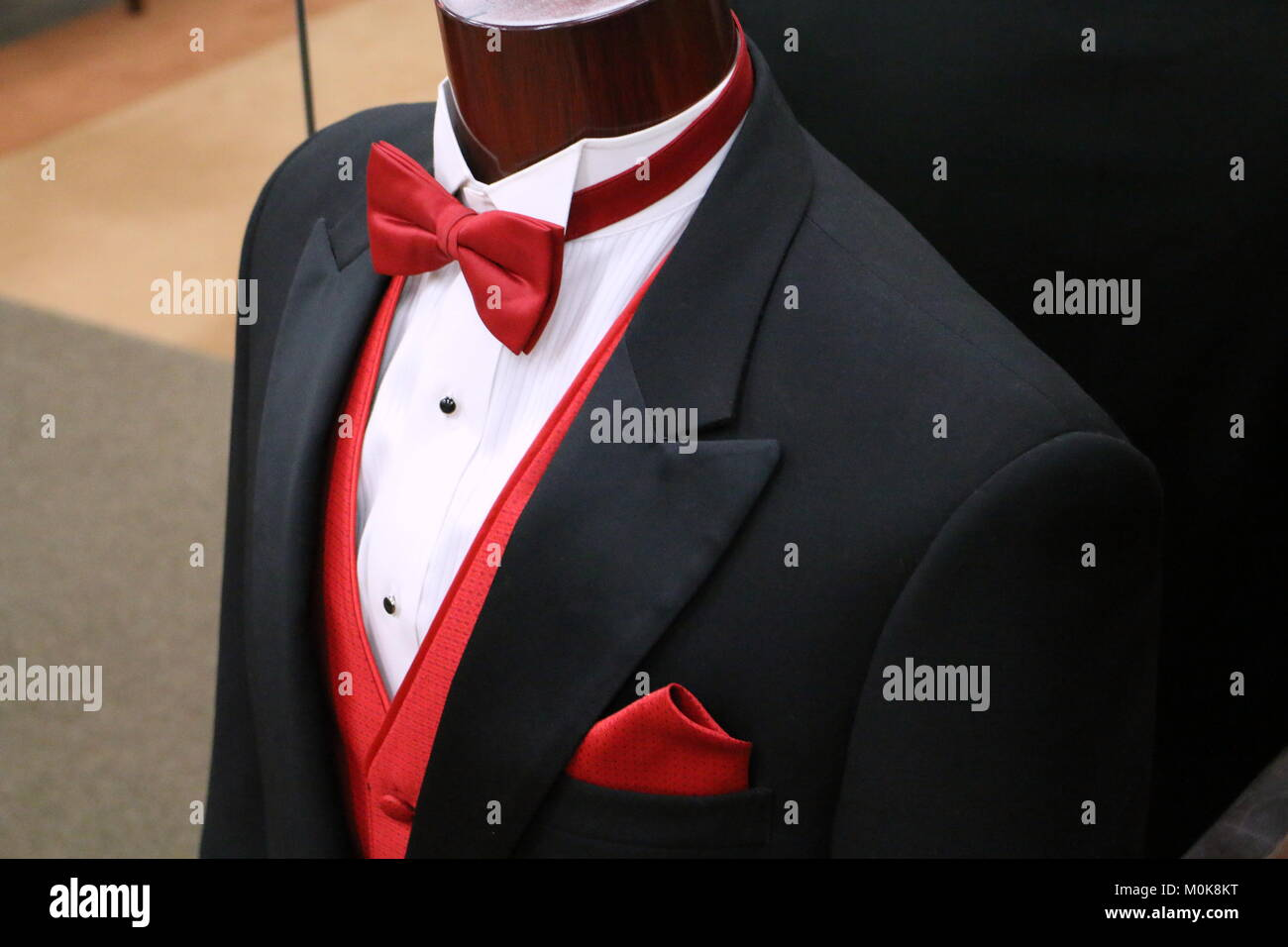 1b13b42d Black Tuxedo with Red Vest and Red Bow Tie Stock Photo: 172527596 ...