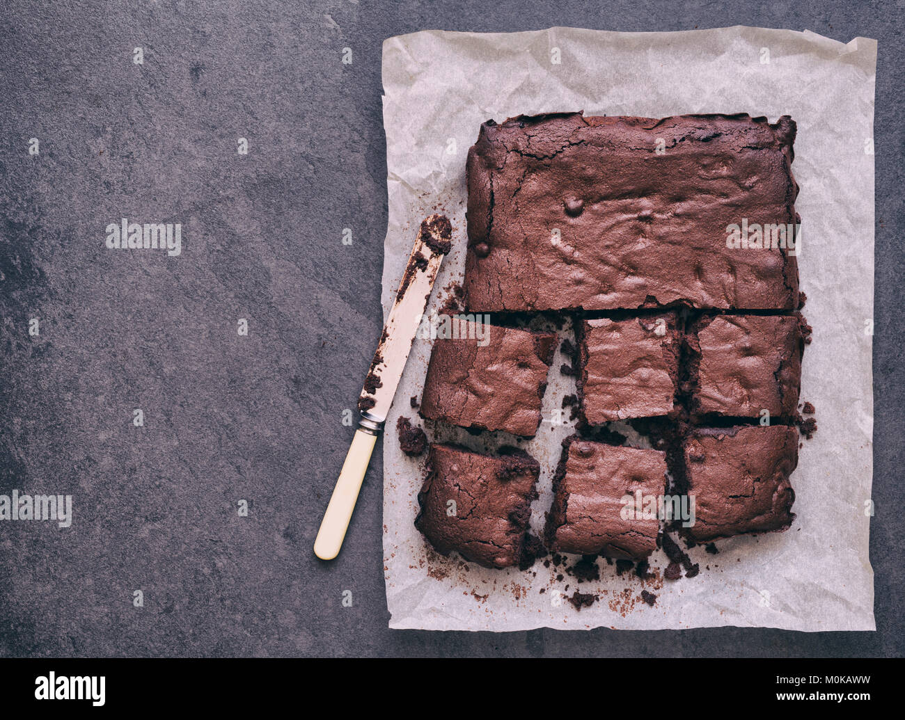 Homemade Chocolate Brownies on a slate background - Stock Image