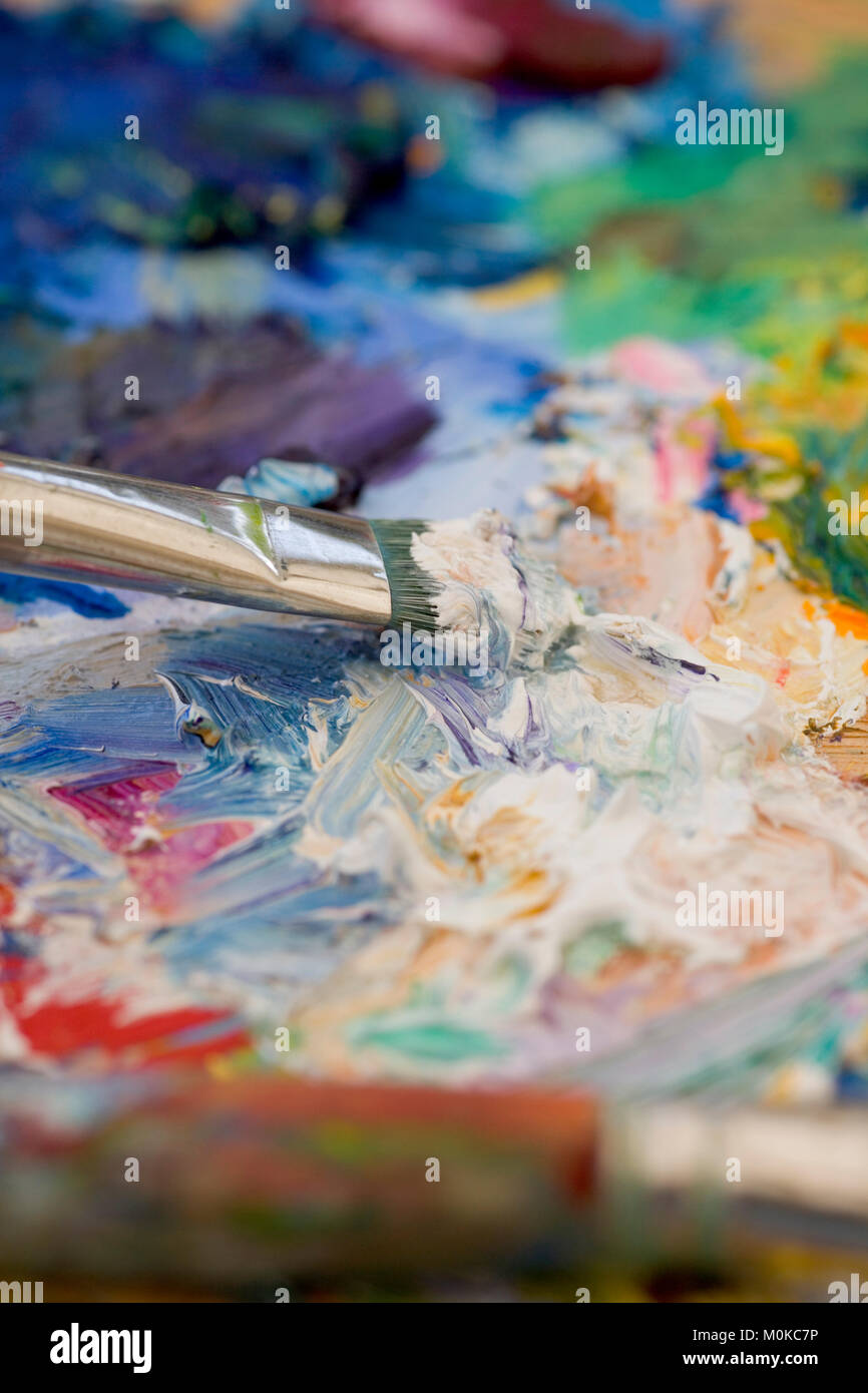 Artists oil paints and brushes multi coloured close up semi abstract Stock Photo