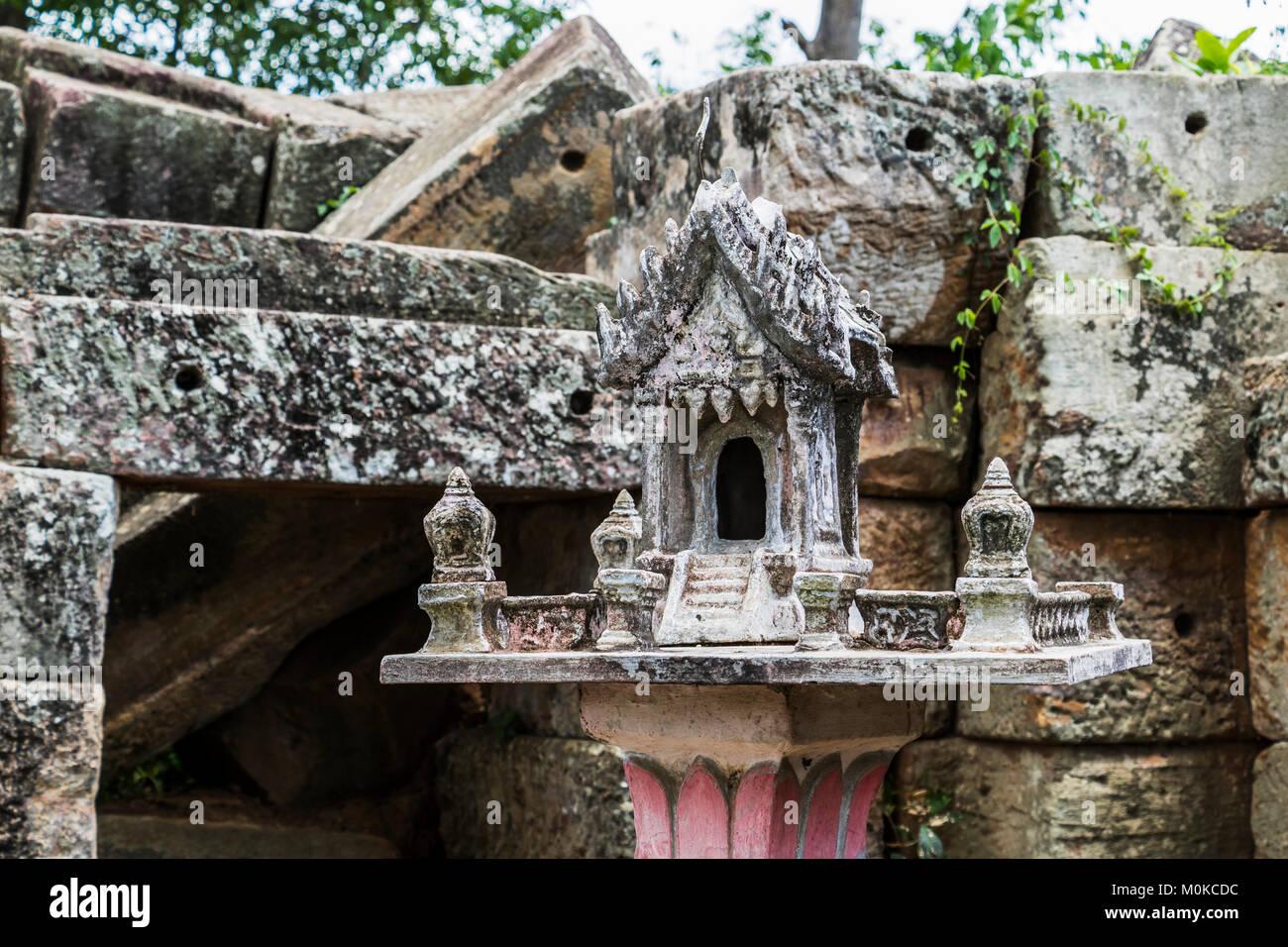 Spirit house by the ancient Angkorian temple at Wat Ek Phnom; Battambang, Cambodia - Stock Image