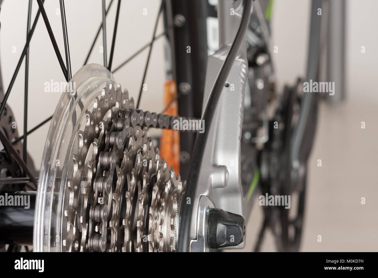 Close up 9-speed Montain bike cassette on rear wheel of bike; studio photo. - Stock Image