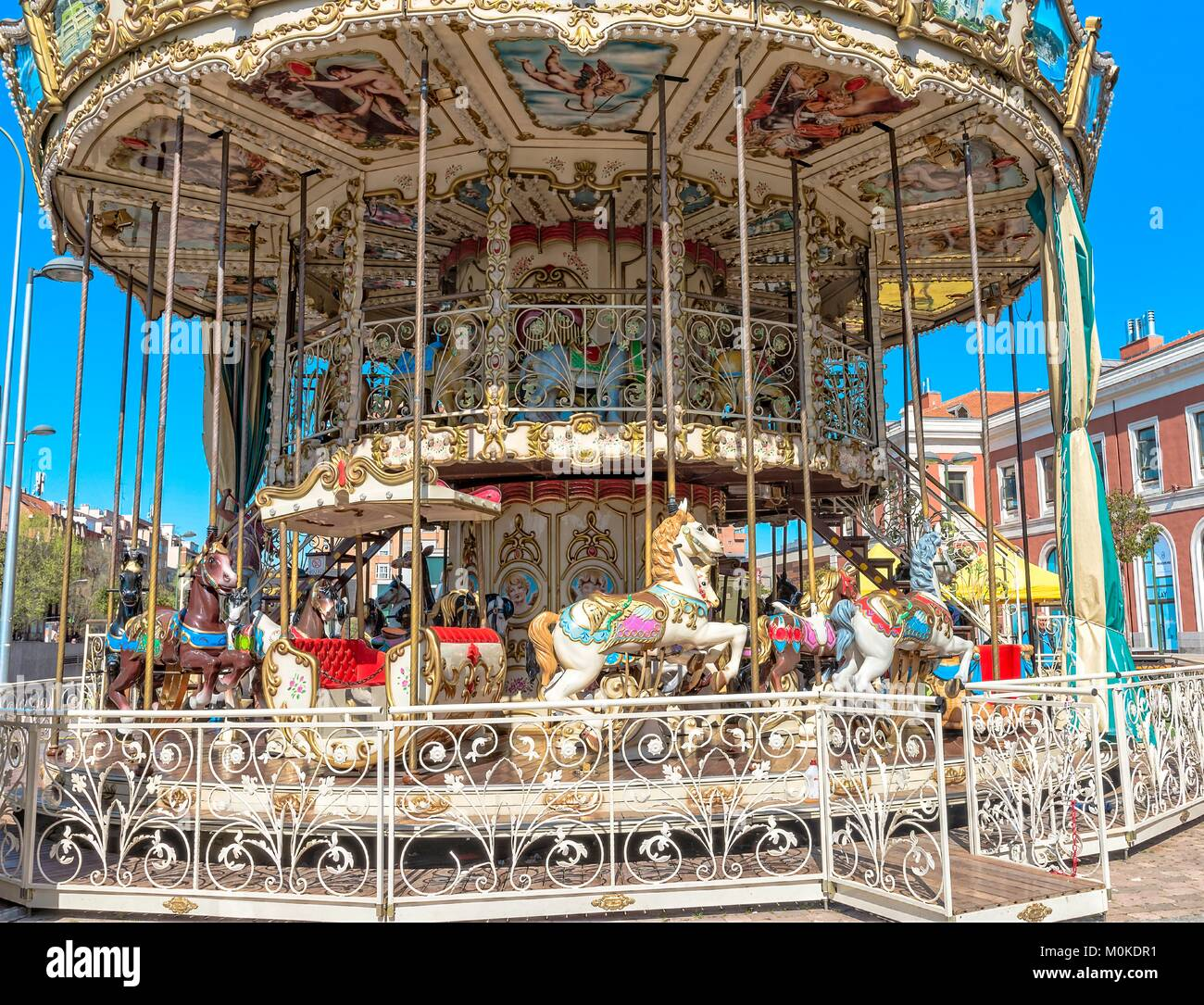 Carousel in Madrid, Spain.  A colourful and pretty carousel situated outside a station in Madrid. Stock Photo