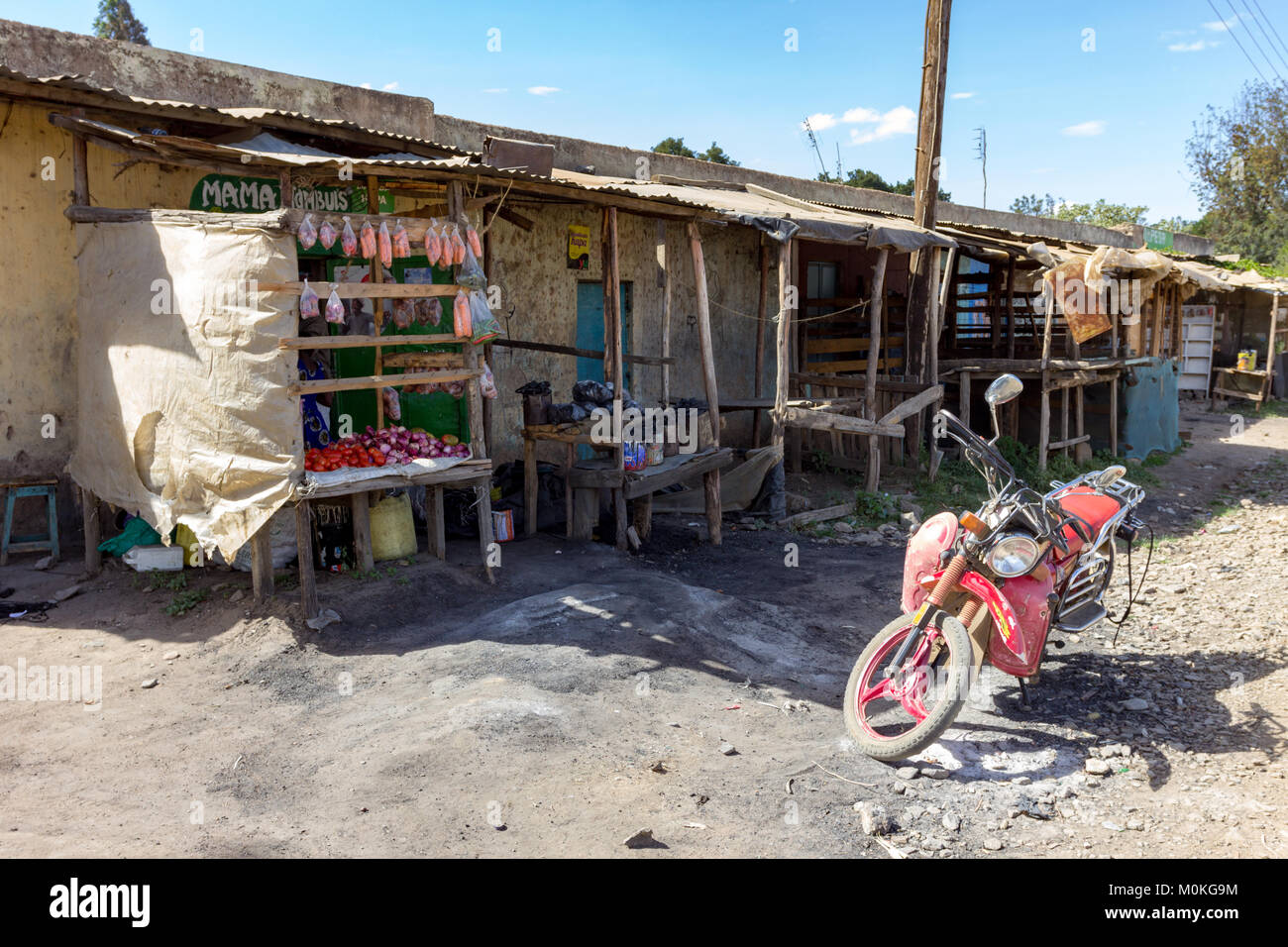 Lifestyle scene of a row of homes with makeshift shop fronts in Nanyuki, Kenya. Stock Photo