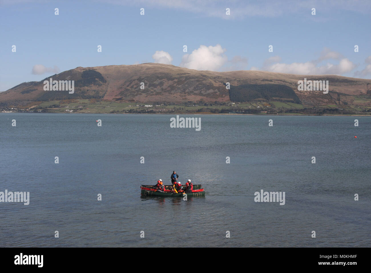Children kayaking at Carlingford Lough, Carlingford, County Louth Ireland. The activity is one of several activities - Stock Image