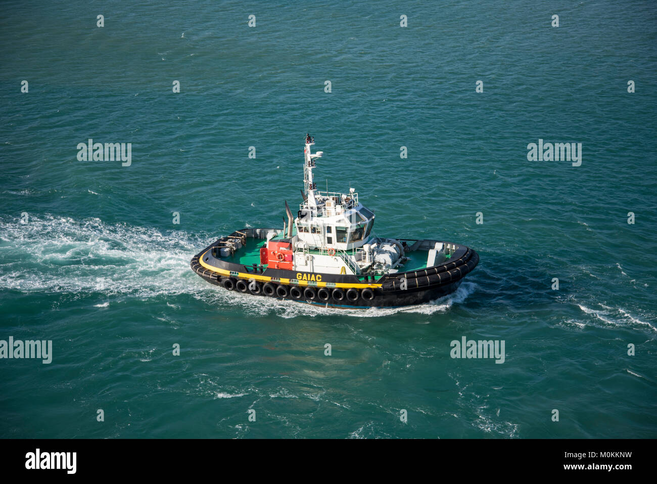 Tug boat in operation from the port of Noumea. - Stock Image