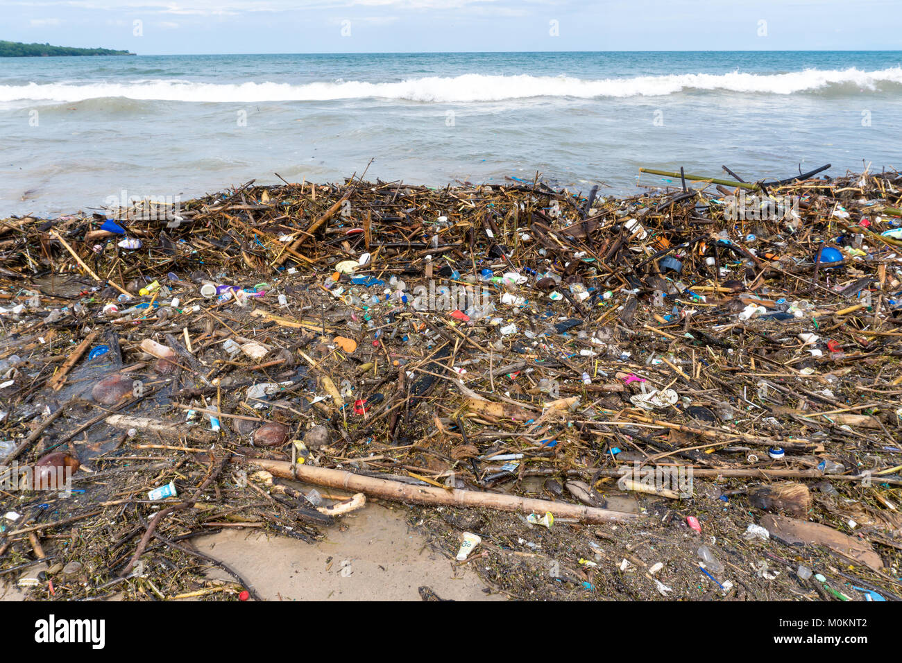 Beach Garbage. Rubbish washed up on shore line - Stock Image