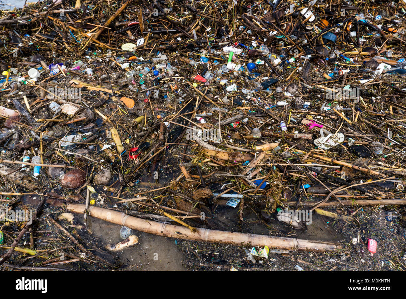 Rubbish and domestic waste polluting the beach. Stock Photo