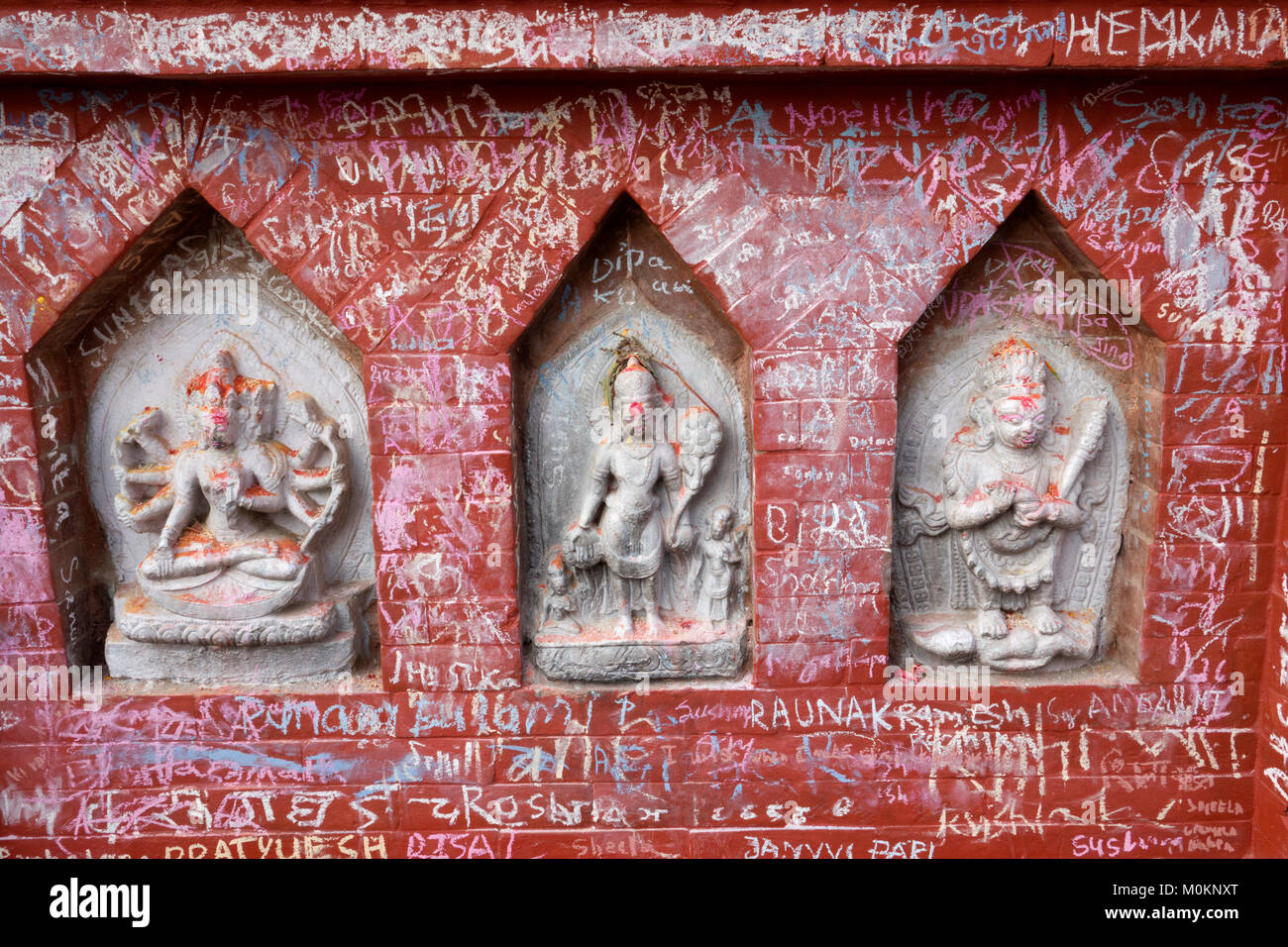 Chalk covered shrines at Swayambhunath Buddhist temple, Kathmandu, Nepal - Stock Image