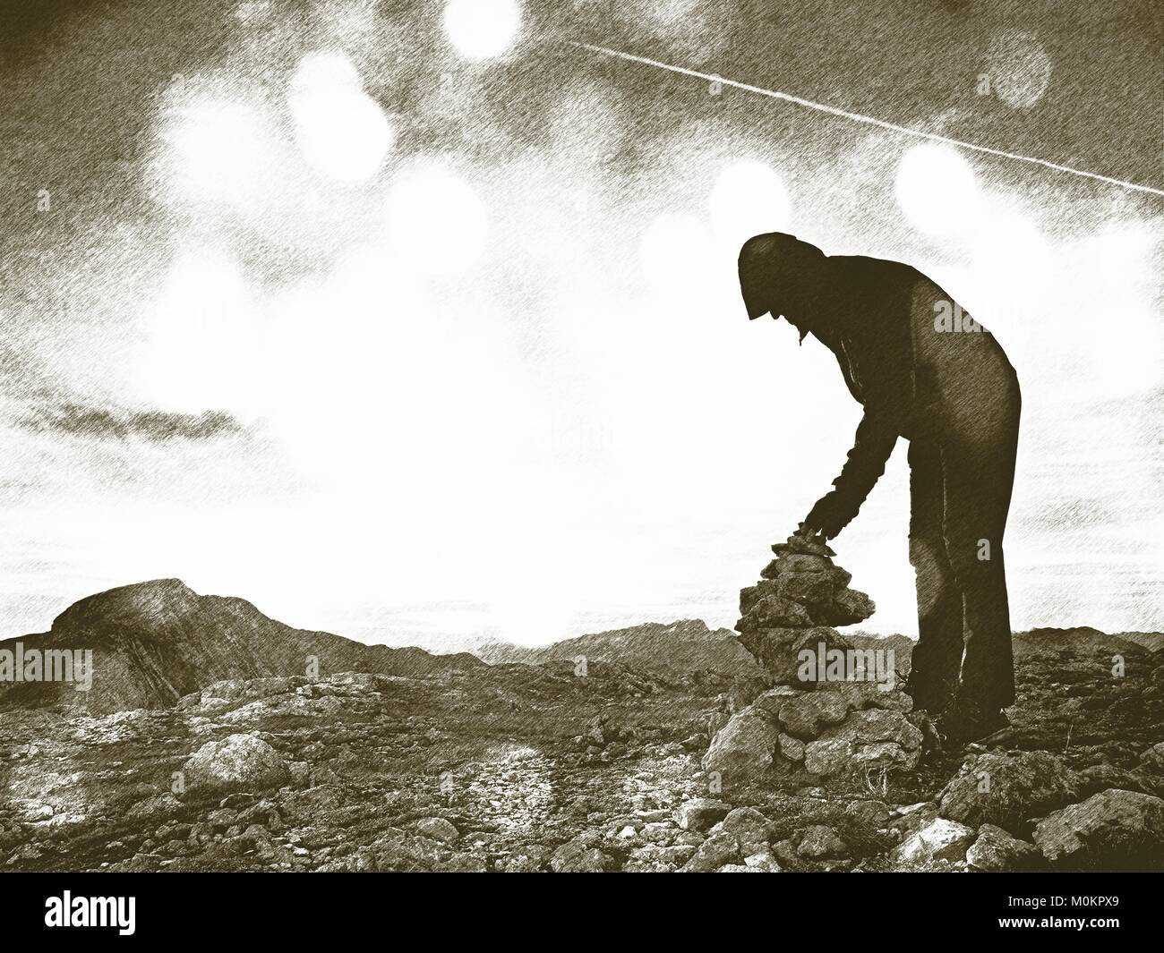 Copy of old lithographic technique. A  man is stocking stone to pyramid. Alps mountain summit, evening sun - Stock Image