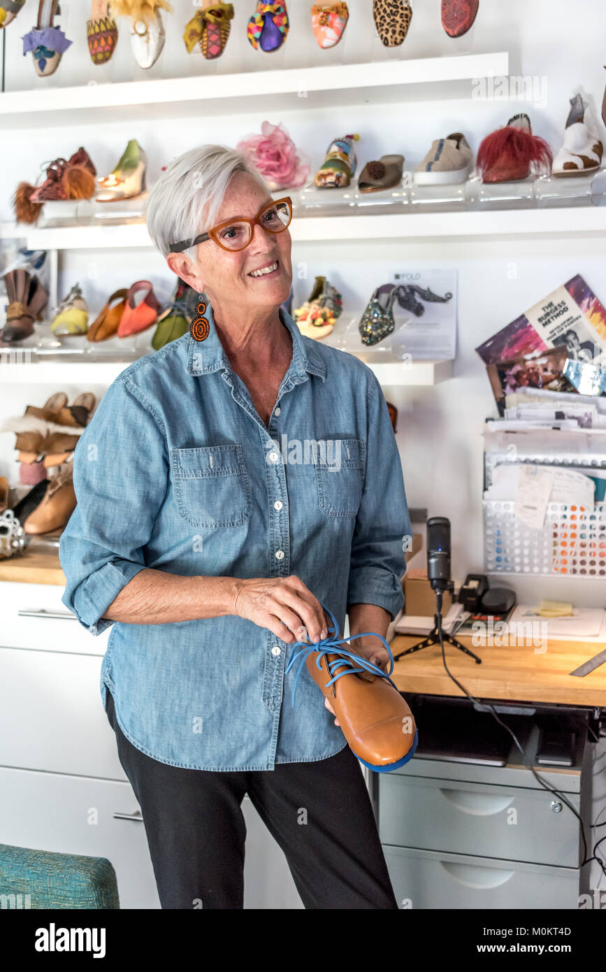 Palm Springs artisan shoemaker Debra Hovel in her Makerville Studio; she designs custom shoes for her clients and - Stock Image