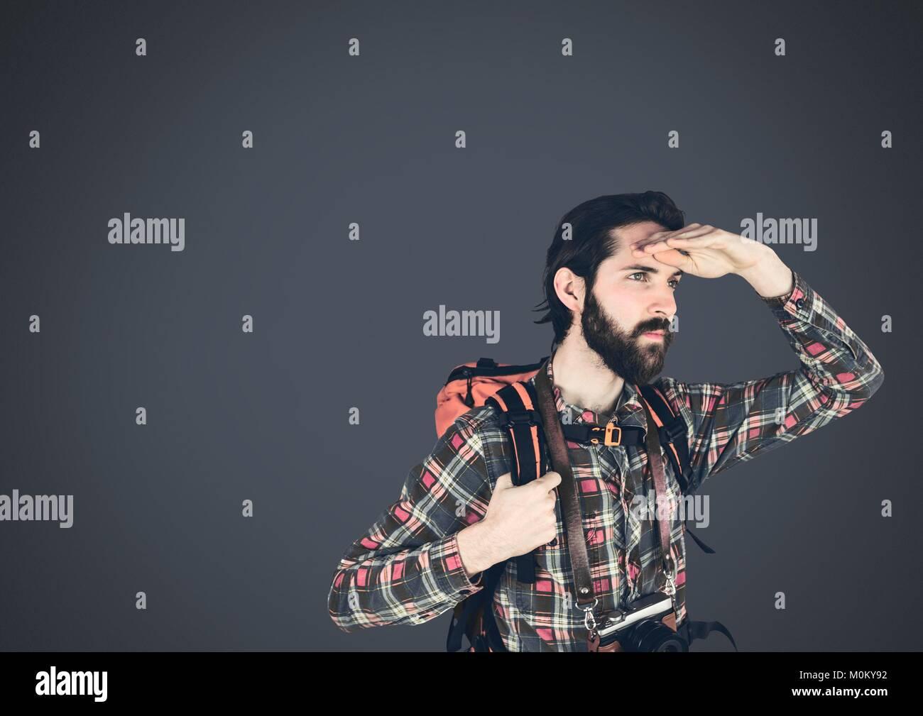 Traveler adventurer man with dark background - Stock Image
