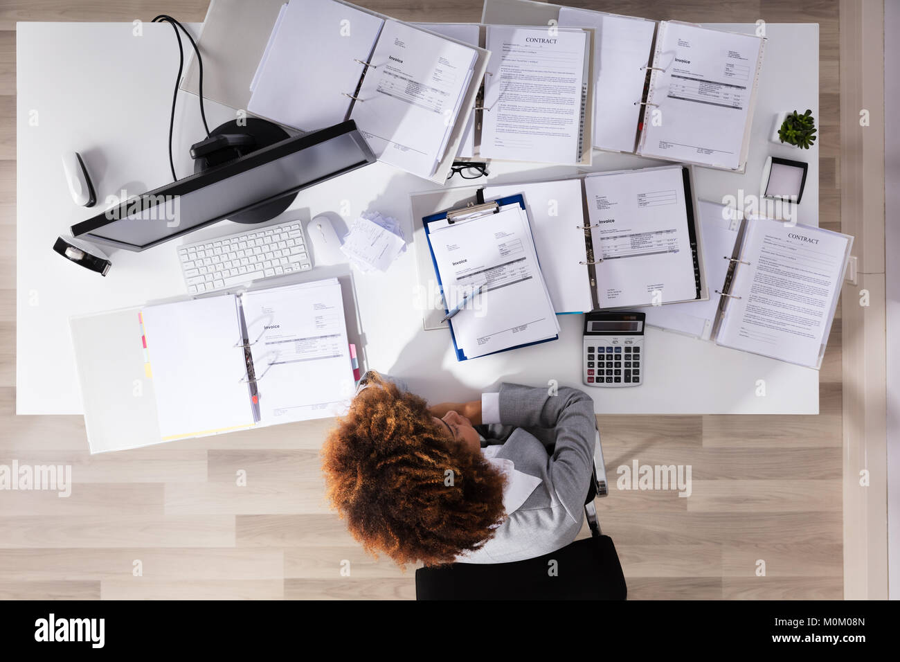 Elevated View Of Unhappy Afro American Businesswoman Sitting In Office Stock Photo