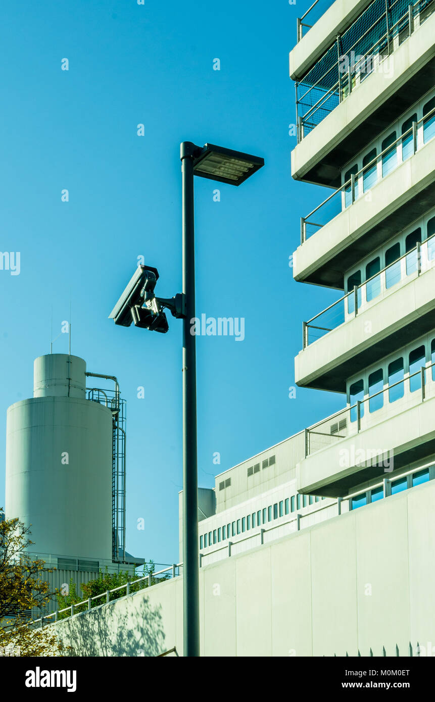 Surveillance camera and security concept - Surveillance cctv camera on pole in factory industrial with copyspace, - Stock Image