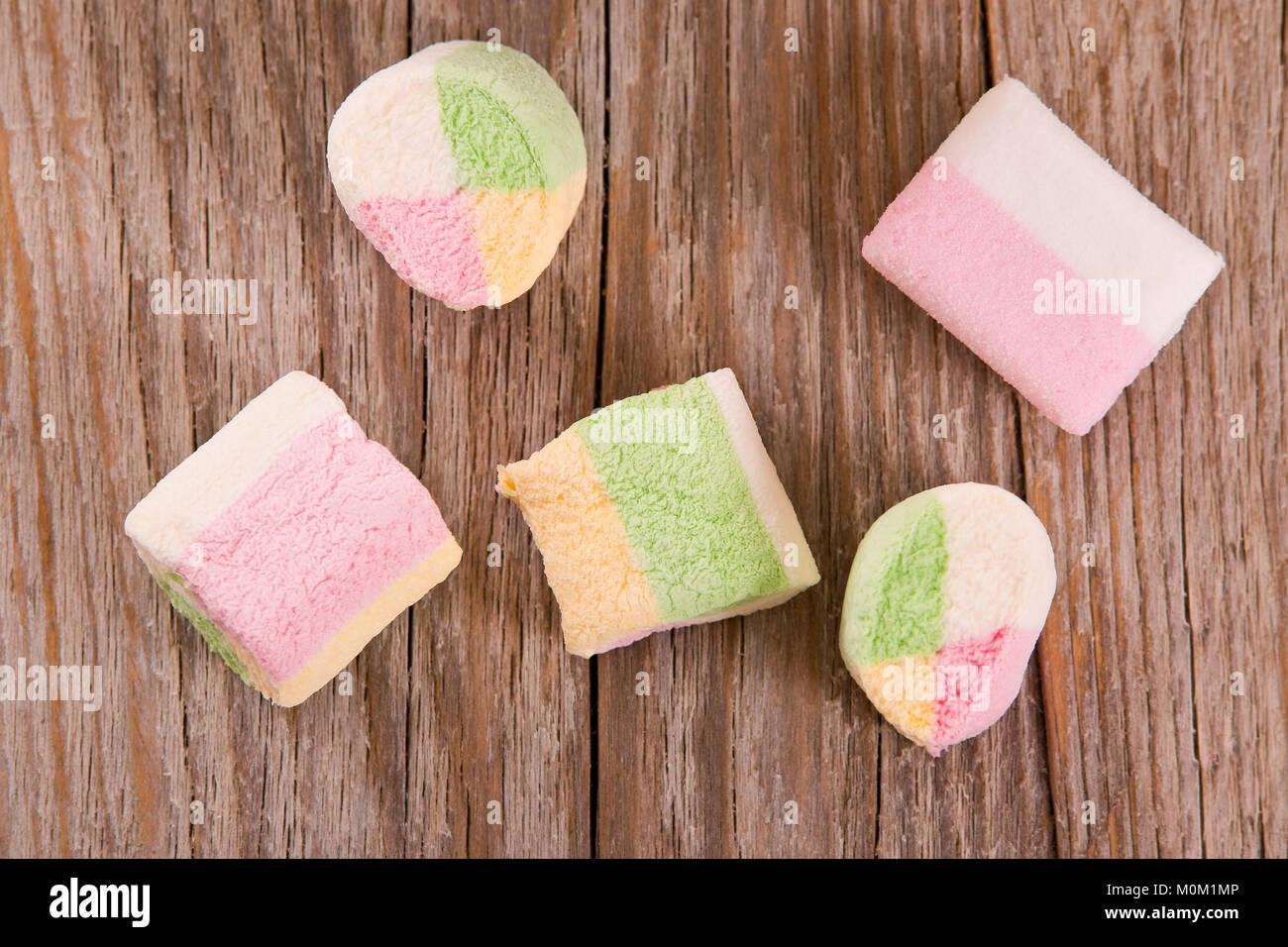 Marshmallows on wooden table. - Stock Image