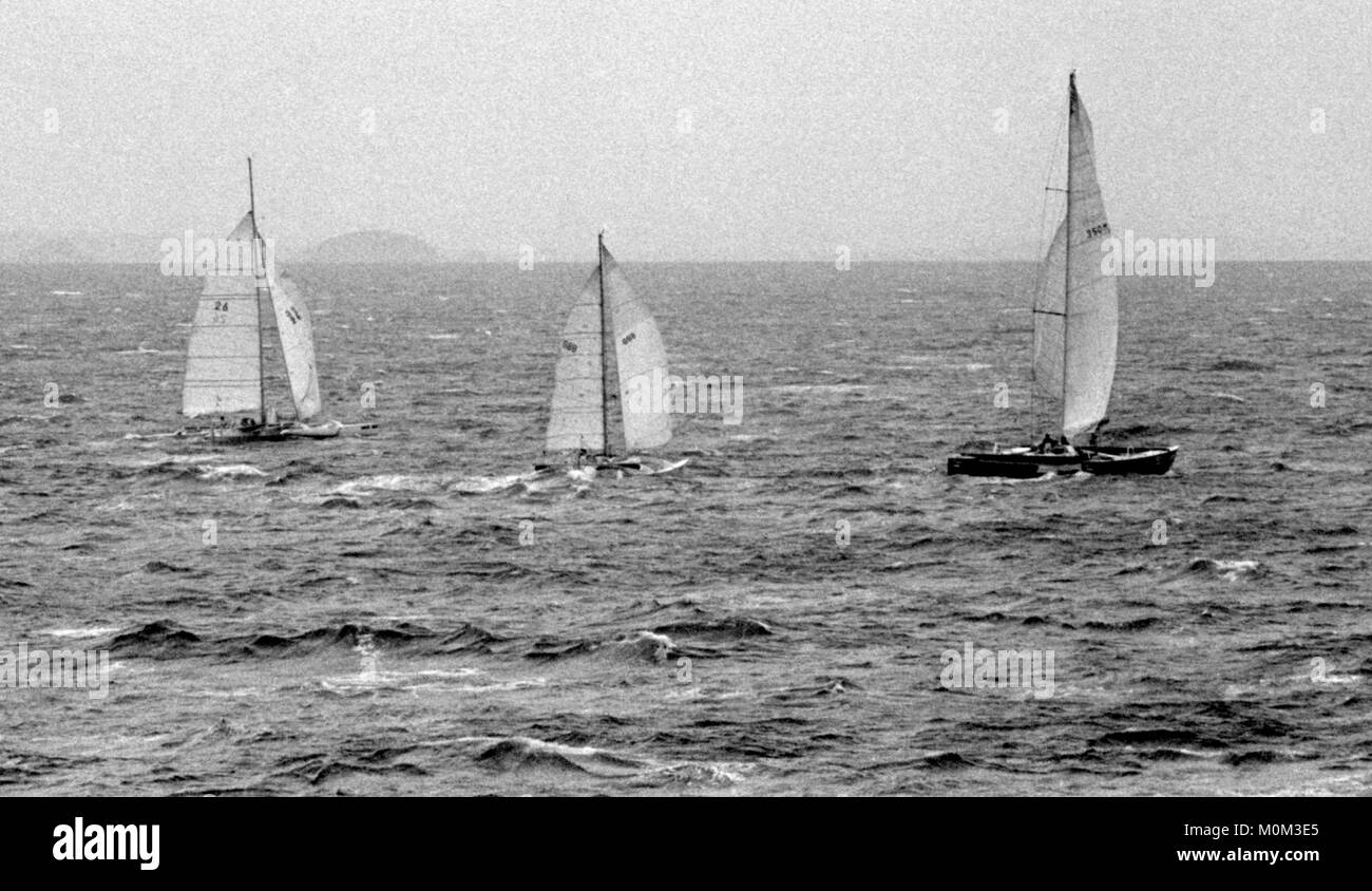 AJAXNETPHOTO. NOVEMBER, 1982. ST.MALO, FRANCE. - START OF THE SECOND ROUTE DU RHUM RACE IN THE BAE OF ST.MALO; (L - Stock Image