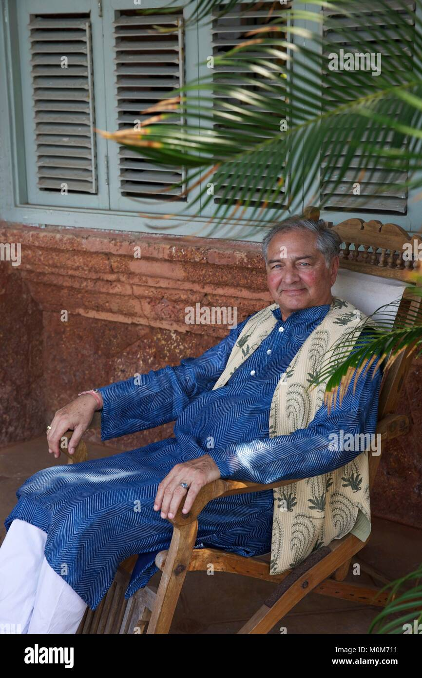 India,Goa,Coco beach,Richard Holkar,son of the maharadjah of Indore,seatting in a chair in his luxury hotel Ahilya - Stock Image