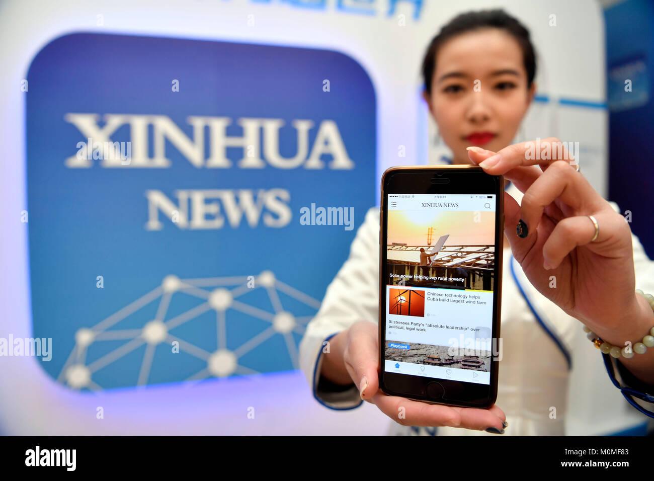(180123) -- BEIJING, Jan. 23, 2018 (Xinhua) -- A staff member shows the Xinhua News App, in Beijing, capital of Stock Photo