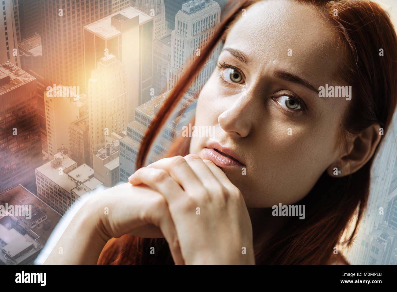 Stressful sad woman sitting and feeling bad herself. - Stock Image