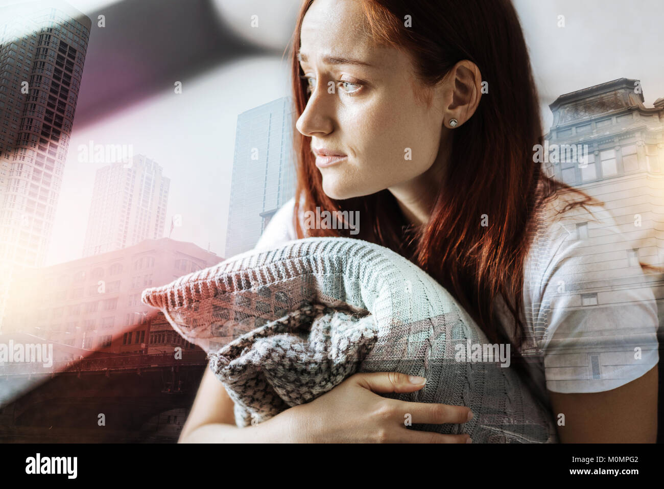 Stressful redhead woman looking aside and thinking. - Stock Image